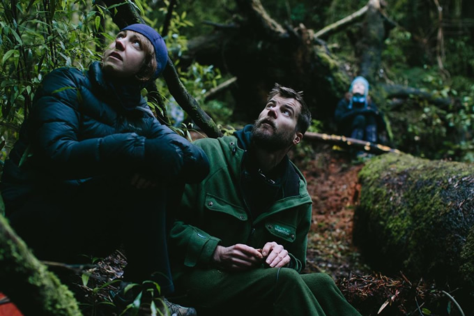 Amanda Rogers and Dave Bryden operating the recording controls to lure in a wild kōkako.