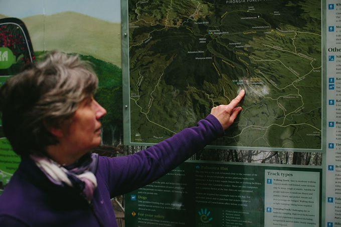 Pirongia Te Aroaro o Kahu Restoration Society Chair Clare St Pierre points to the kōkako release site within the predator-controlled forest