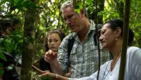 Robert Hoare talks about a moth seen in the field at Bushy Park with teacher Tiahuia Kawe-Small.
