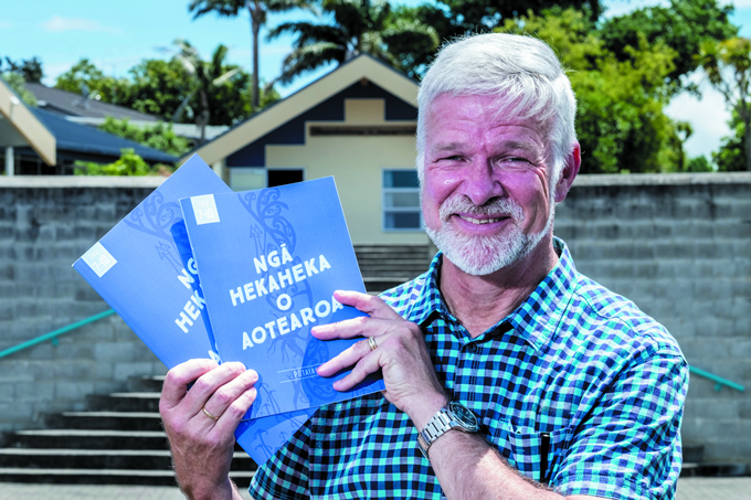 Dr Peter Buchanan holding Ngā Hekaheka o Aotearoa, a booklet he co-wrote on traditional Māori uses of fungi, launched at a kura kaupapa in Auckland.