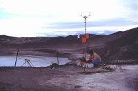 Ian Hawes downloading data from a climate station at Bratina Island.