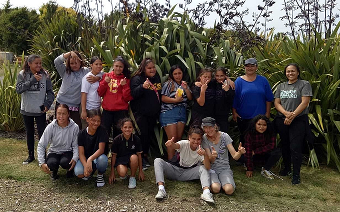 Haeata Community Campus ākonga and teachers taking part in the programme in front of The National NZ Flax with Katiaki Katarina Tawiri