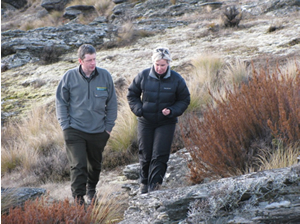 Andy Hutcheon (DOC) and Andrea Byrom inside the predator-proof fence at Macraes Flat