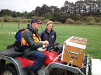 Paul Peterson and Dr Carolyn Hedley with a quad bike that has a gamma sensor mounted to the front to collect soil carbon information.