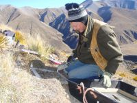 Ian Lynn collecting samples during the high country carbon survey.