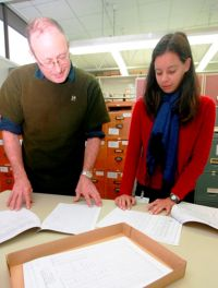 Research technicians Hamish Maule and Elise Arnst working with NVS records.