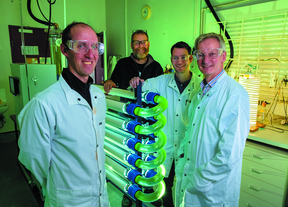 Manaaki Whenua phycologist Phil Novis (left) with University of Canterbury staff in the university's CAPE algal lab.