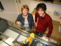 Fig. 2: Carolyn Hedley and Pierre Roudier with a new automated soil core scanner for direct measurement of volumetric soil organic carbon content