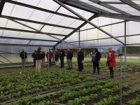 Figure 1. Programme scientists and an industry advisory group discussing irrigation trials in the Plant & Food rain-out shelter facility, at Lincoln, where controlled trials are being conducted to investigate the ability of crop sensors to assist spatial crop water use predictions