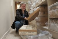 Herbarium manager Ines Schonberger with boxes of specimens